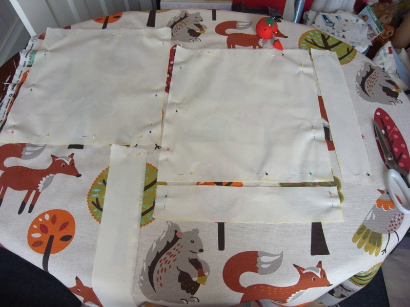 I then plan where I want my pattern pieces and lay the calico on the fabric to use as a template.