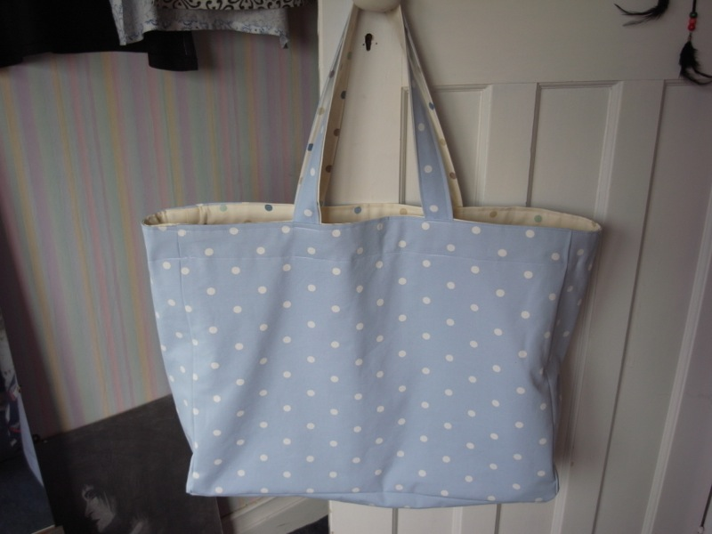 This is a FLIPPING HUGE baby bag! You could put several babies in it and it still wouldn't be full! The person who had it though, was very happy with it.