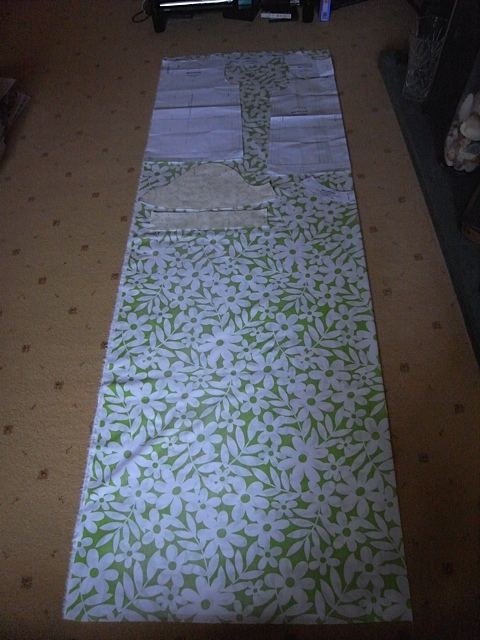 Pattern pieces laid out on the fabric. again I will get 2 tops out of this.