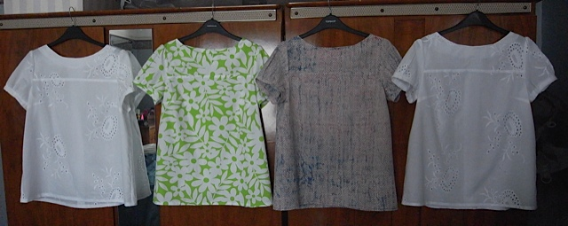 4 short sleeved blouses.