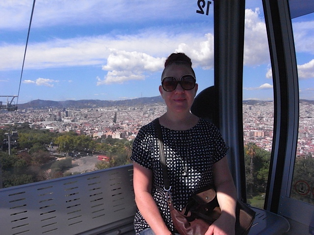 Me in a cable car coming down from Montjuic.
