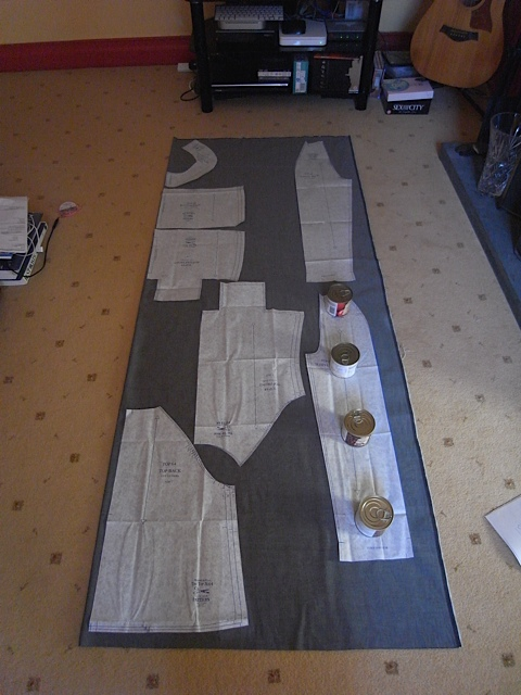 Pattern pieces laid out on fabric. And I now mostly use tins when I cut out.