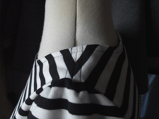 Beautifully matched shoulder seam.