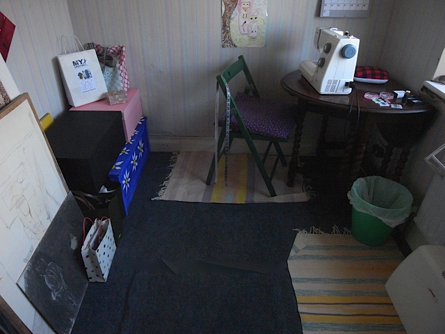 The big black box and the pink box now house my fabric and some scraps that are big enough they might be useful.